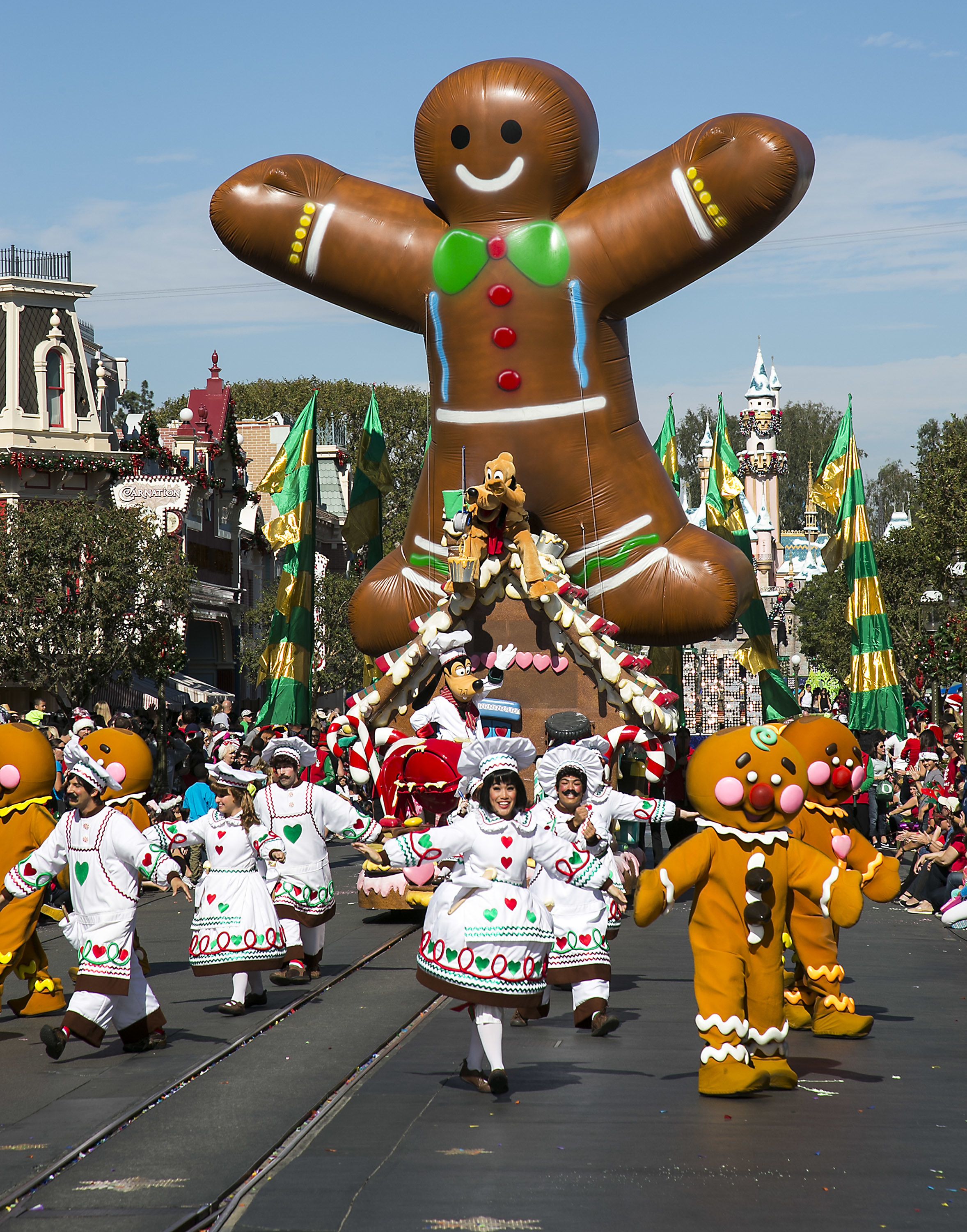 Holiday floats and performers fill Main Street U.S.A at Disneyland