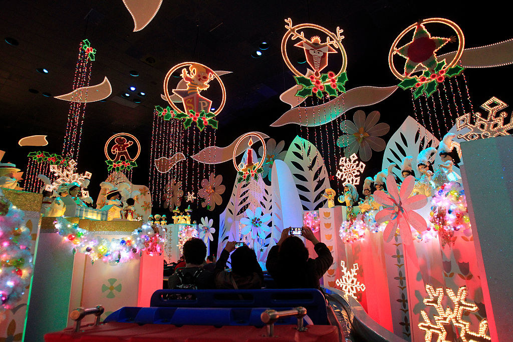 "Disneyland visitors cruise through ""It's a Small World"" featuring different Christmas and holiday celebrations from around the world"