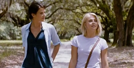 Katie and Jo walk a tree-lined path together