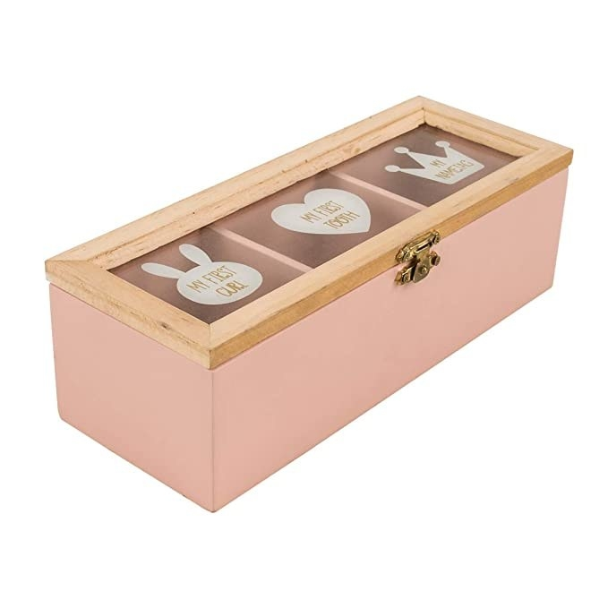 Pink storage box with a clear lid.