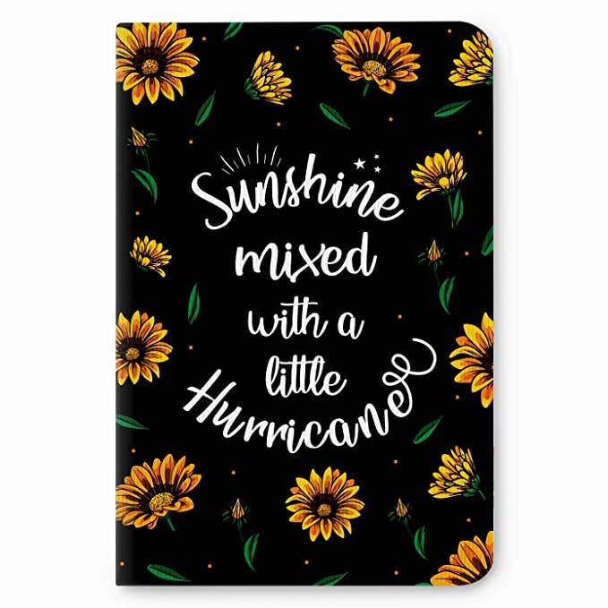Black notebook with sunflowers and the words 'Sunshine mixed with a little hurricane' written on it.