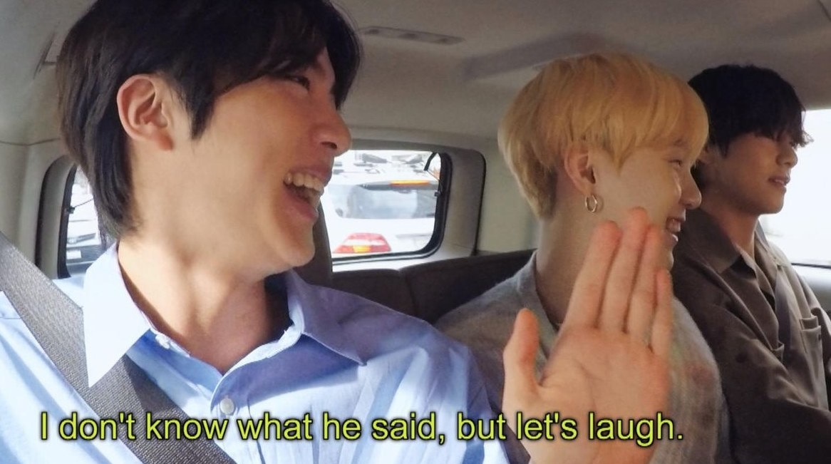 """Jin, Suga, and V sit in the backseat of a car laughing, with the caption reading """"I don't know what he said, but let's laugh"""""""