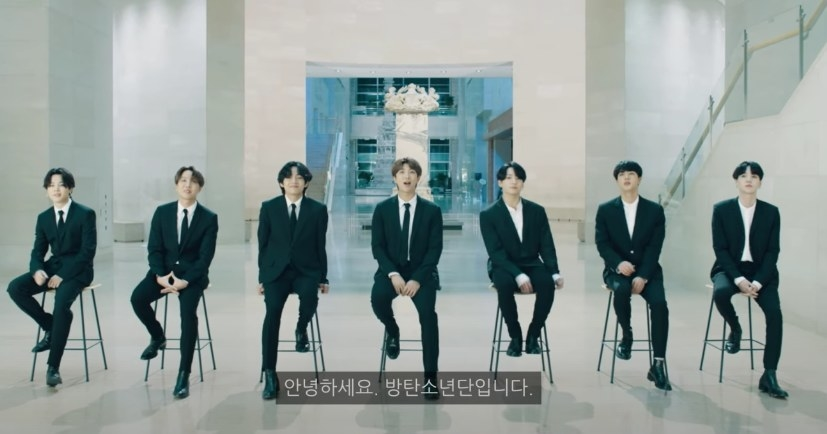 BTS wear suits and sit on stools