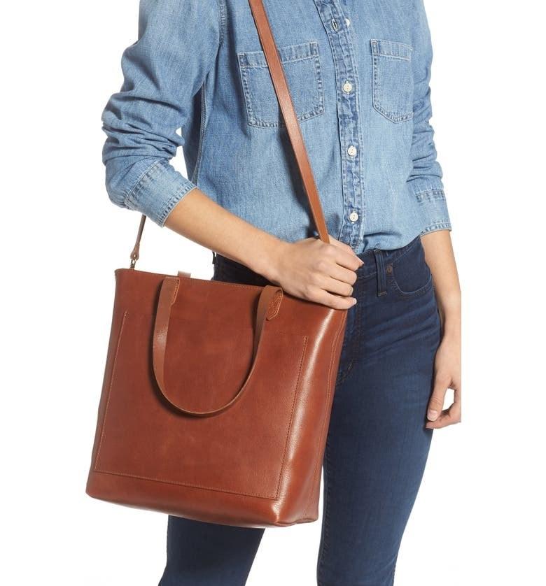 Model wearing the dark brown bag on their shoulder