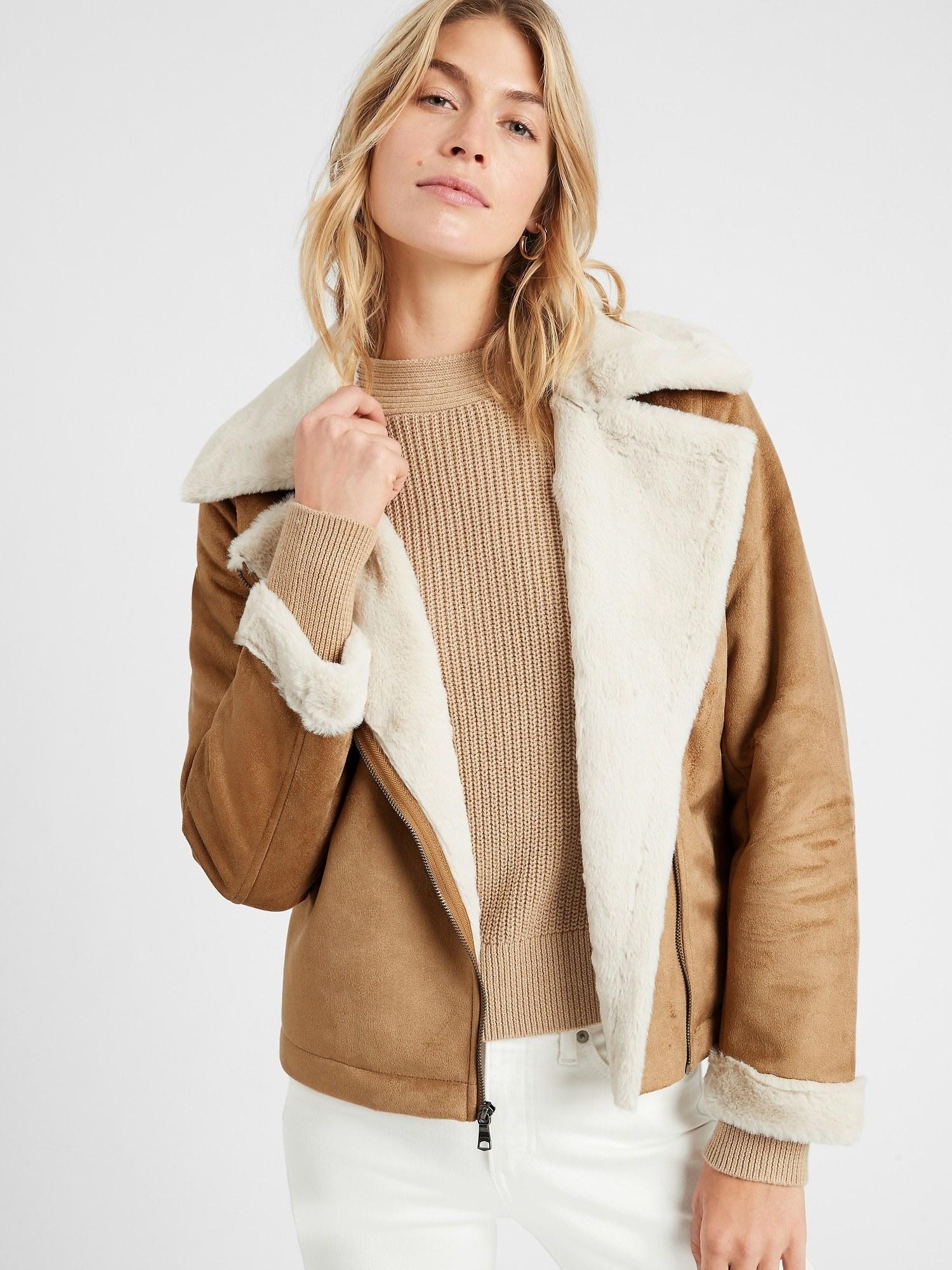 model wearing faux shearling jacket in beige/off white