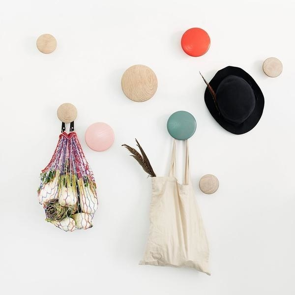 Wooden dot hooks displaying bags and hat