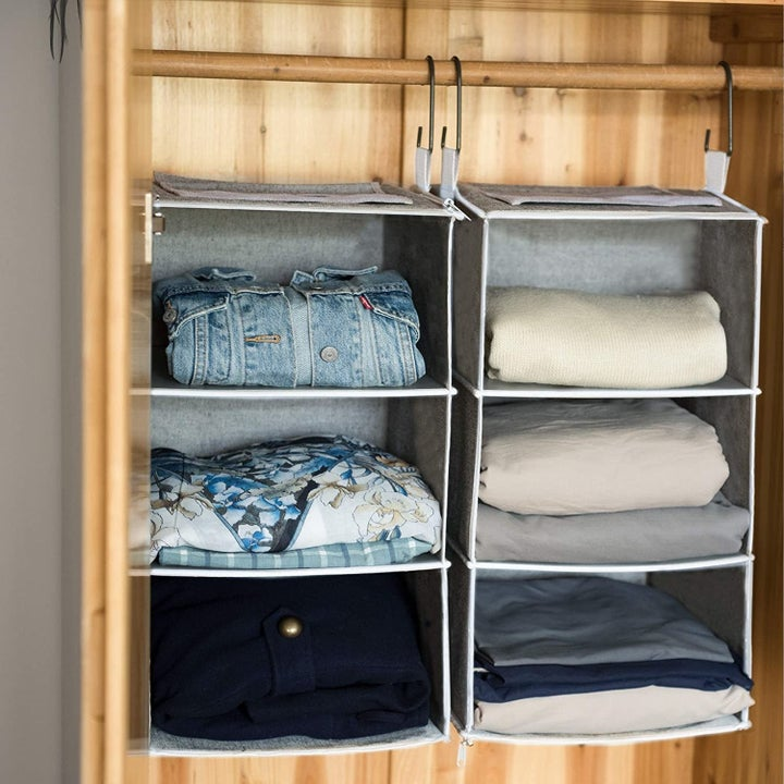 Shirts folded into hanging storage units