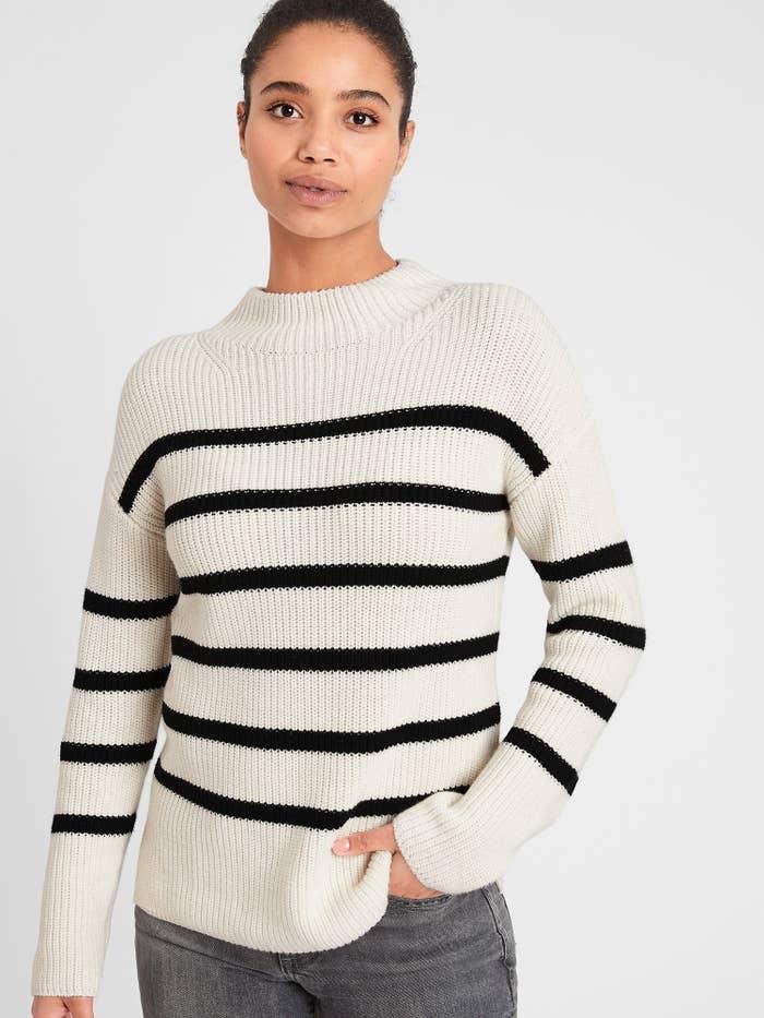 model wearing striped mock neck sweater