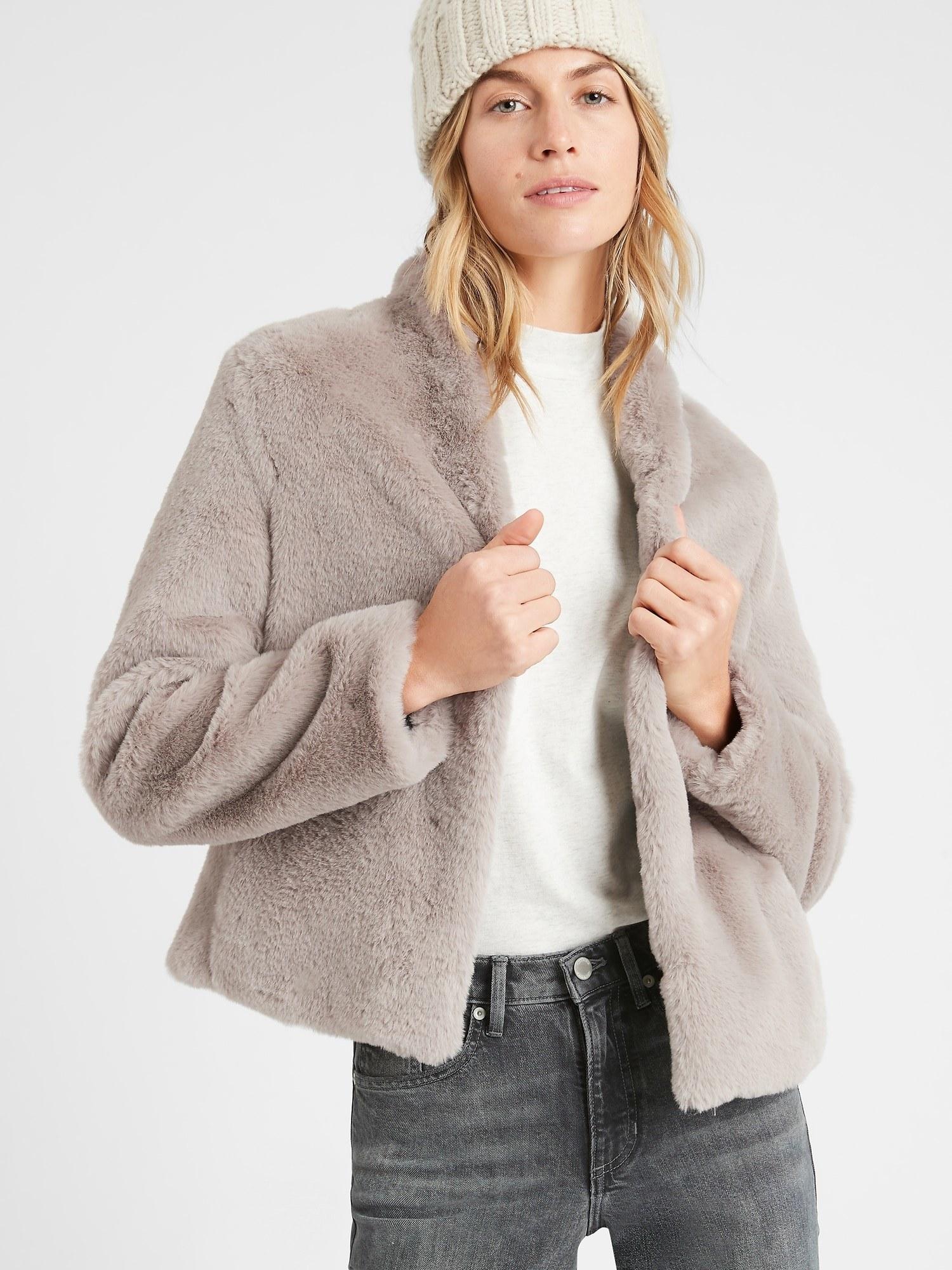 model wearing faux fur jacket