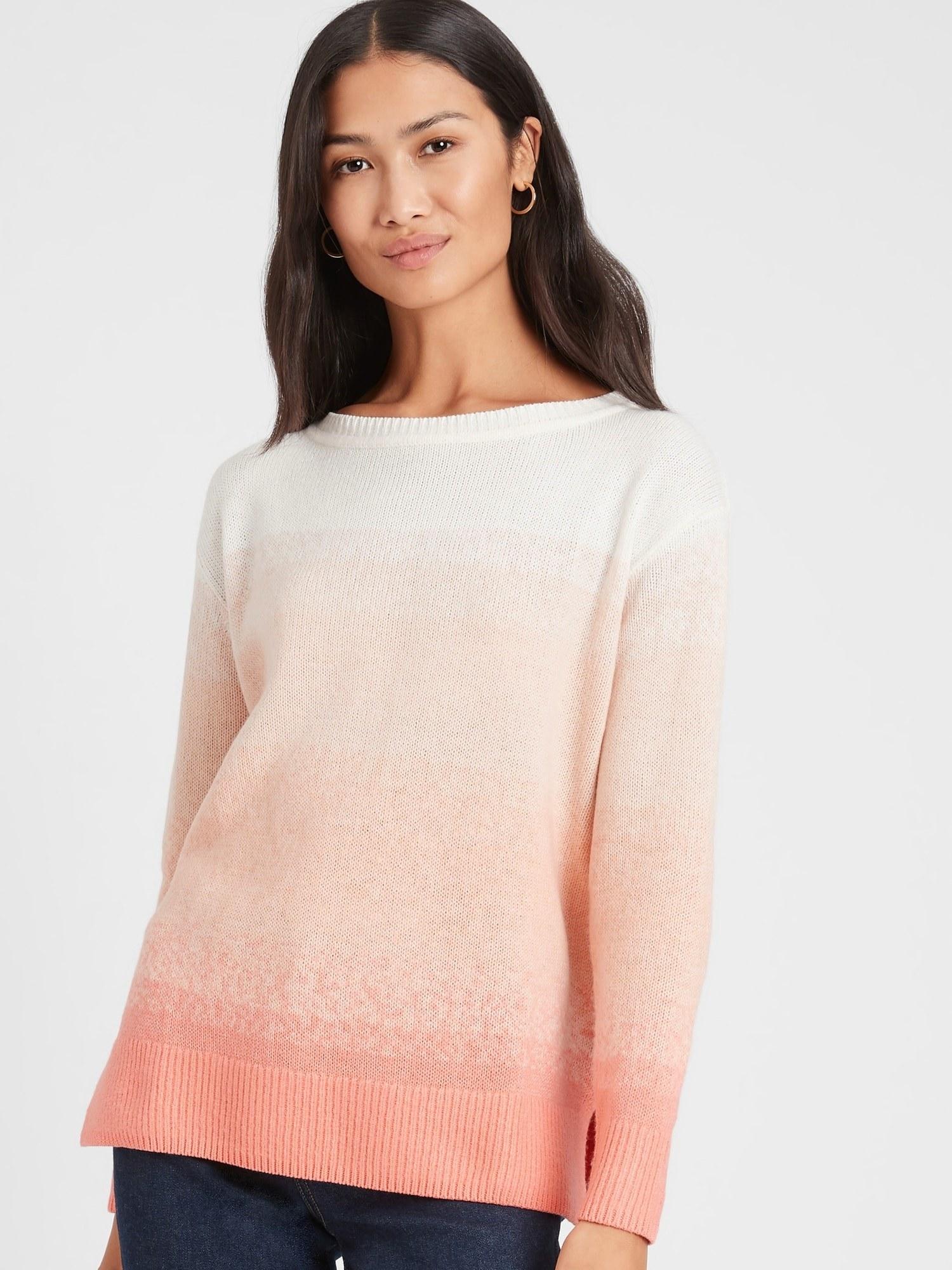 model wearing ombre crewneck sweater in pink sundown