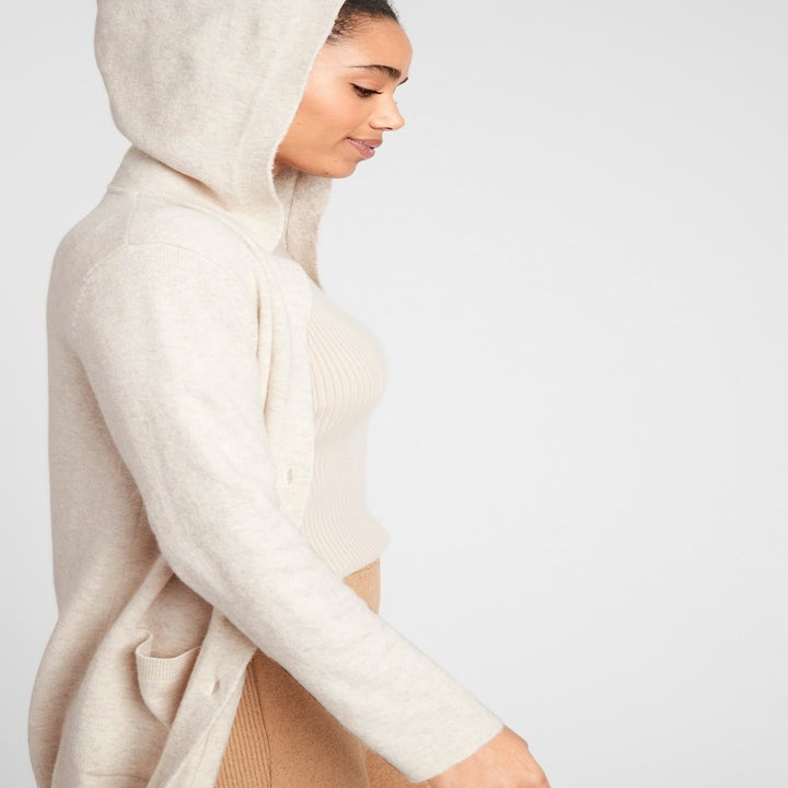 model wearing the duster cardigan with the hood up