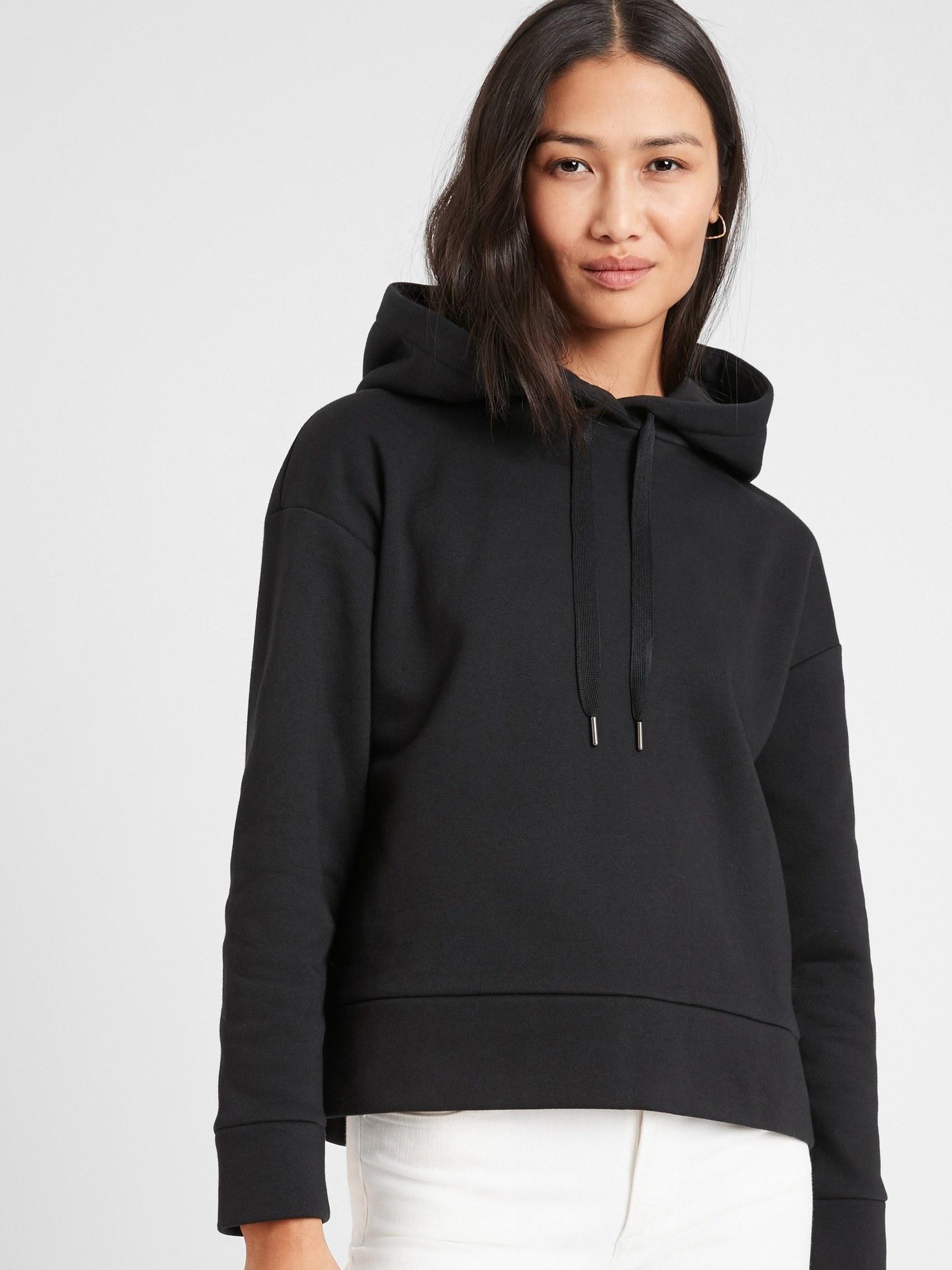 model wearing fleece hoodie in black