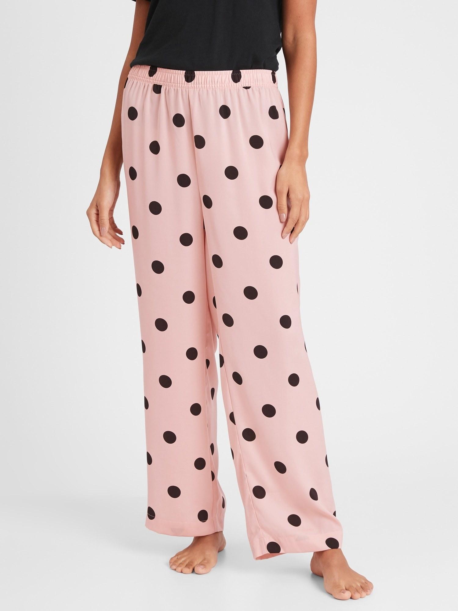 model wearing polka dot pajama pants in pink