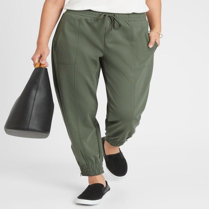same model wearing joggers in green