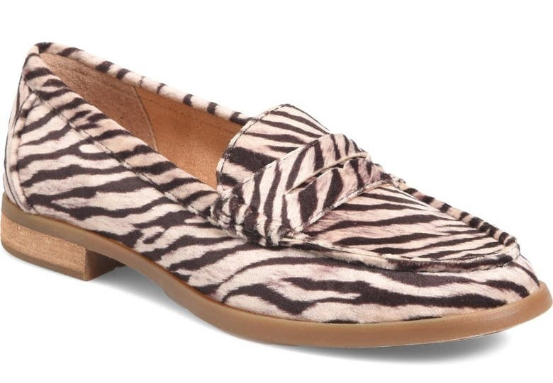 The white and black giraffe-print loafers