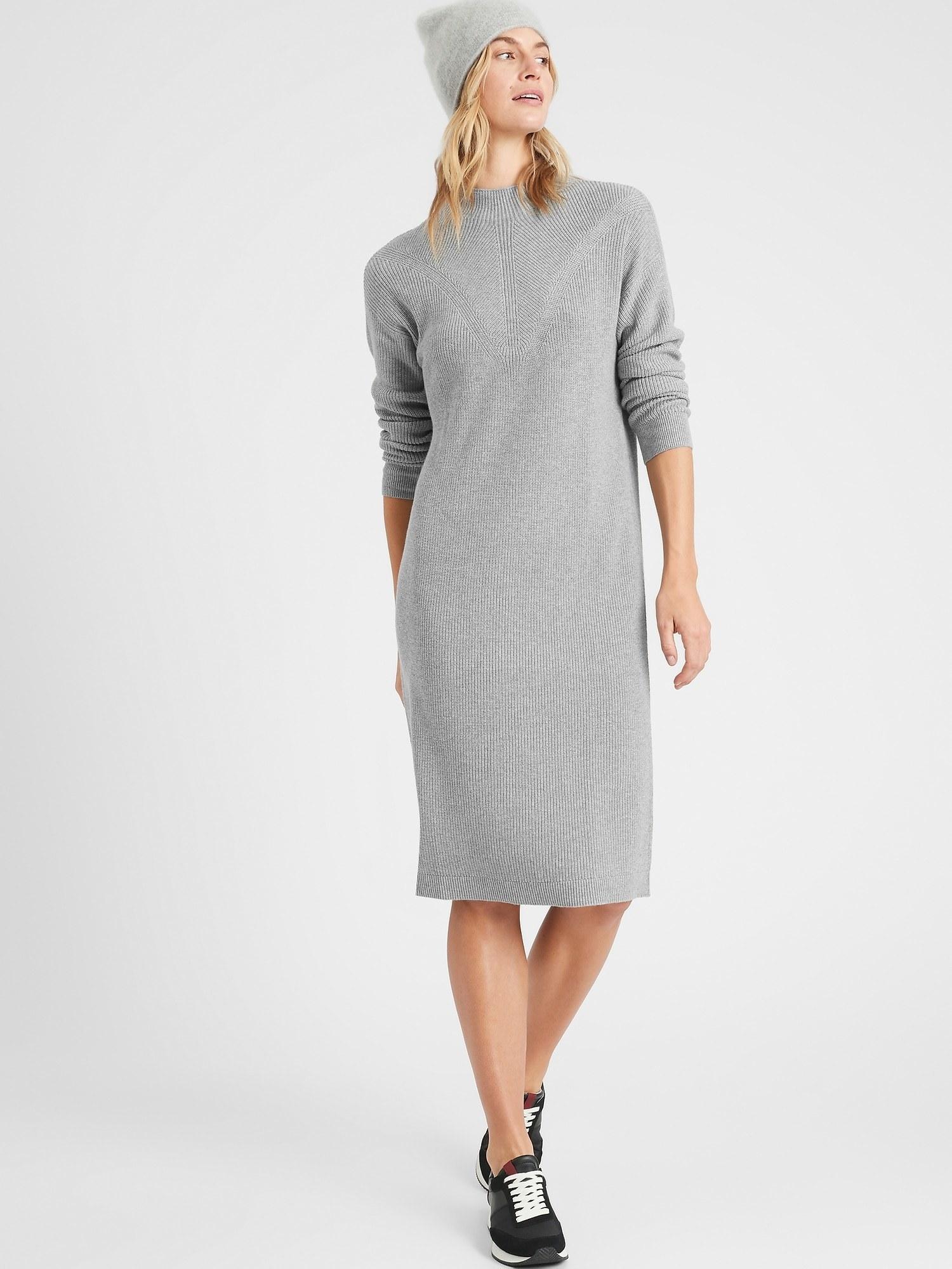 model wearing textured sweater dress in heather grey