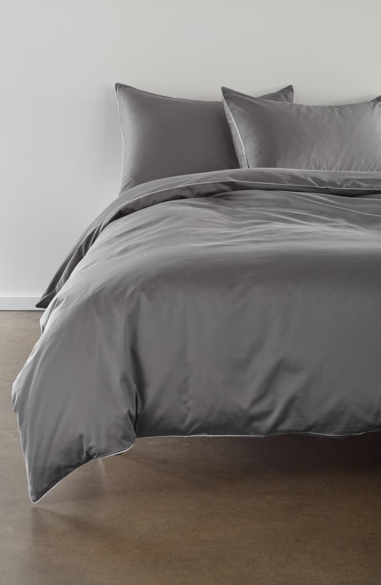 The dark gray duvet cover with white flat piping