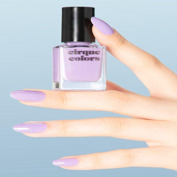Model holding pastel lilac nail polish