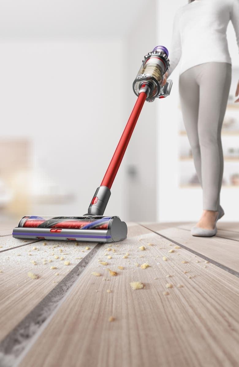 Model using the vacuum to suck up crumbs