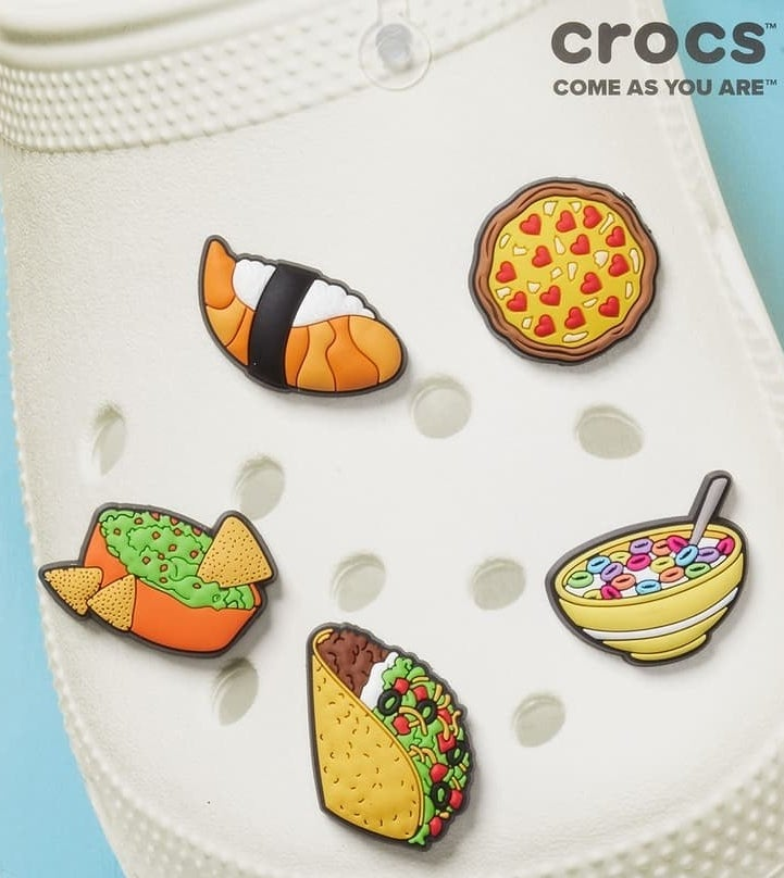 an array of charms for crocs of different foods
