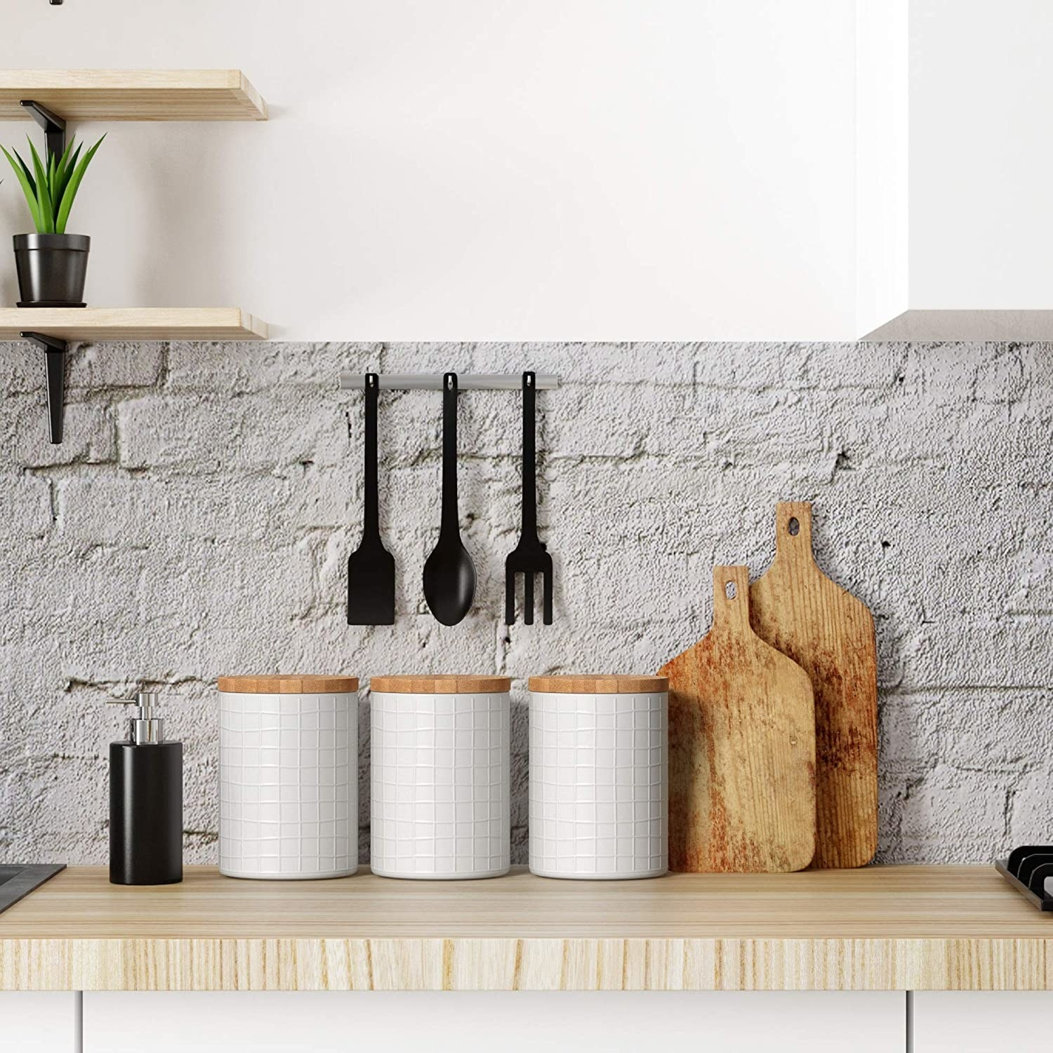 the three barnyard designs kitchen canisters on a kitchen counter