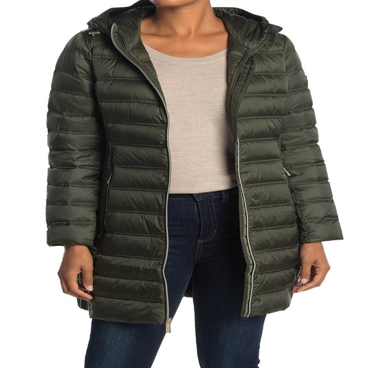 a model in a green puffer jacket