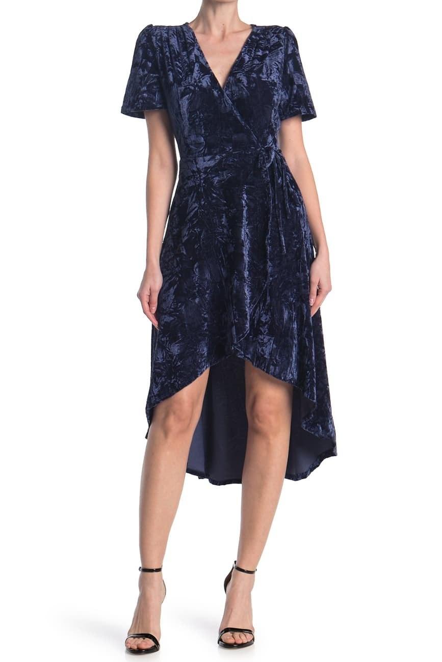 a model in a velvet blue dress
