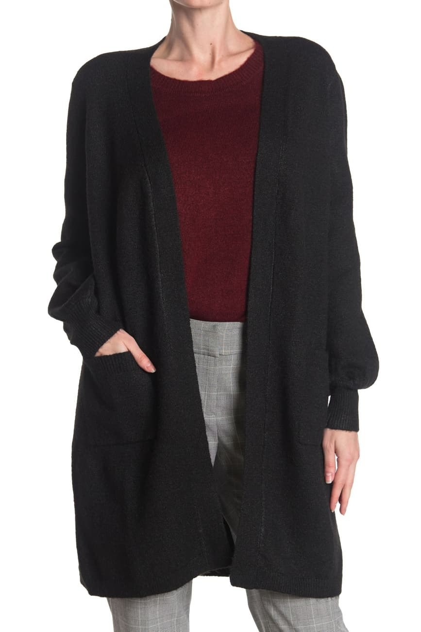 a model in the long black cardigan