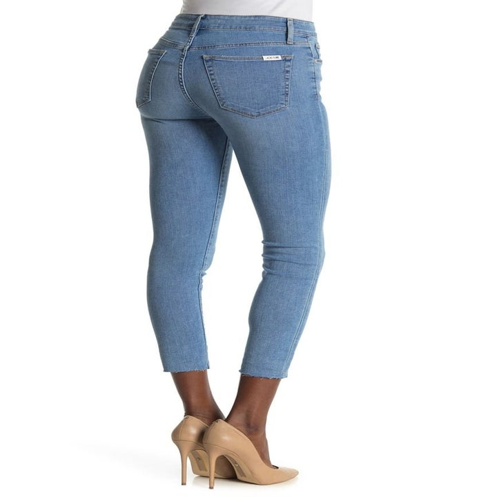 a model showing the back pockets on the jeans