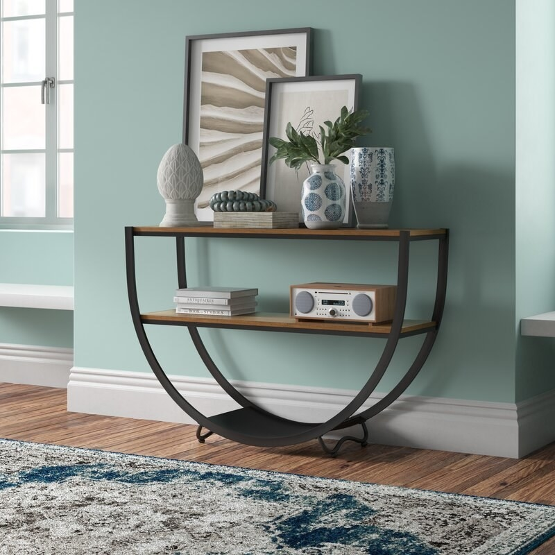 """the joss and main Goodlow 50"""" Console Table against a seafoam wall"""