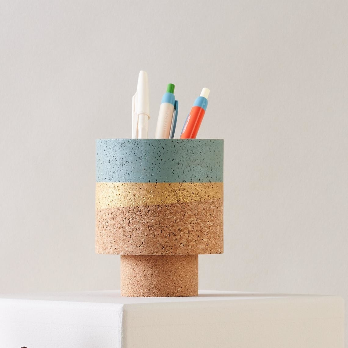 cork planter with small base and yellow and blue stripes