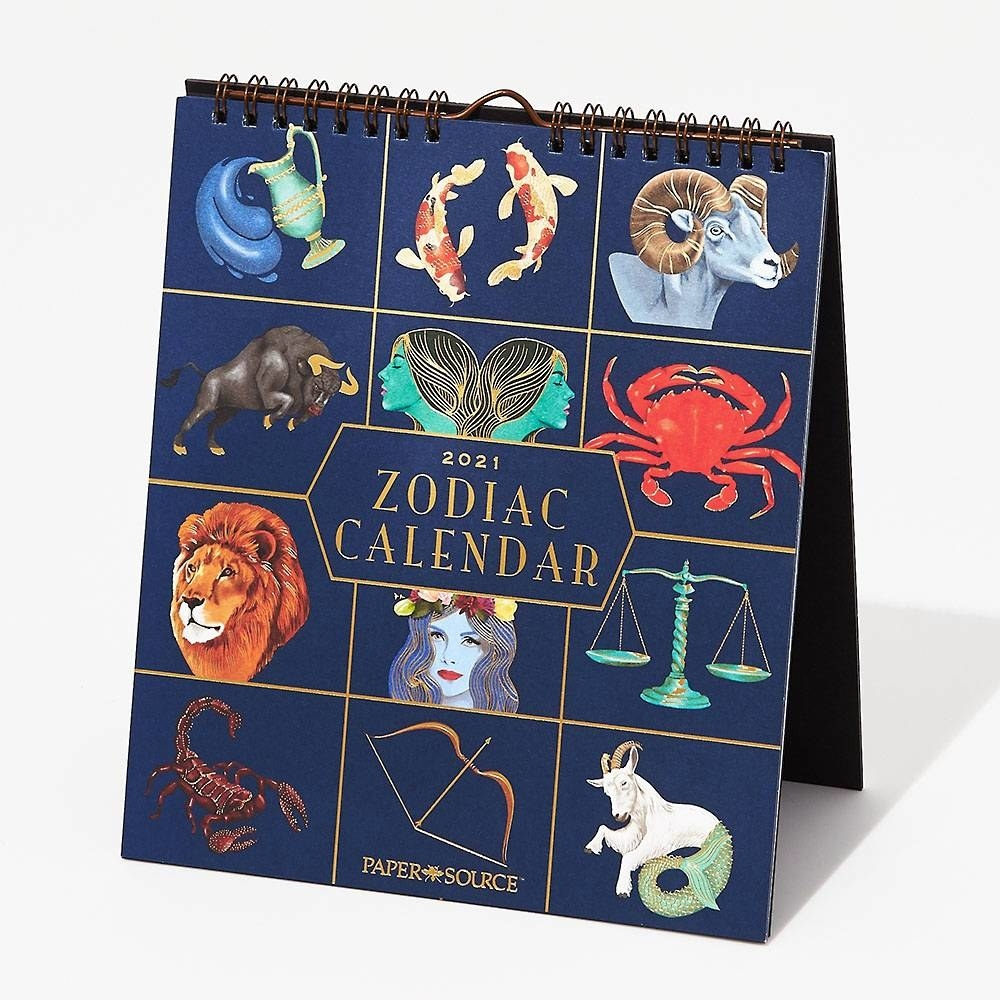 fold over spiral bound calendar with all the zodiacs on the cover