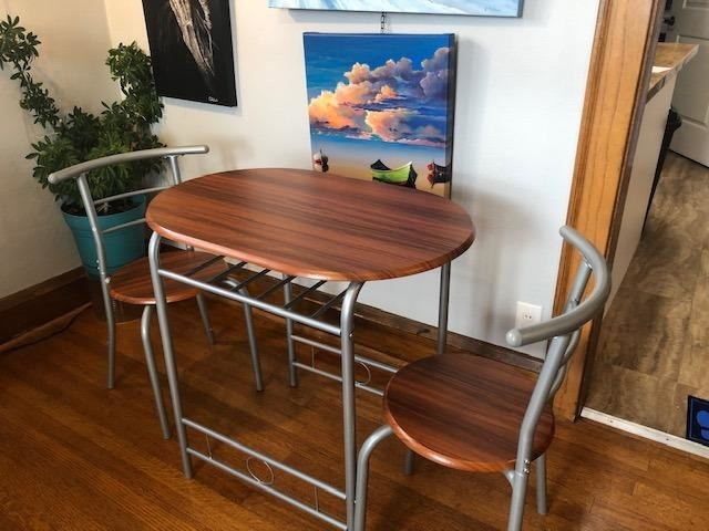 the table and chairs with gray metal accents