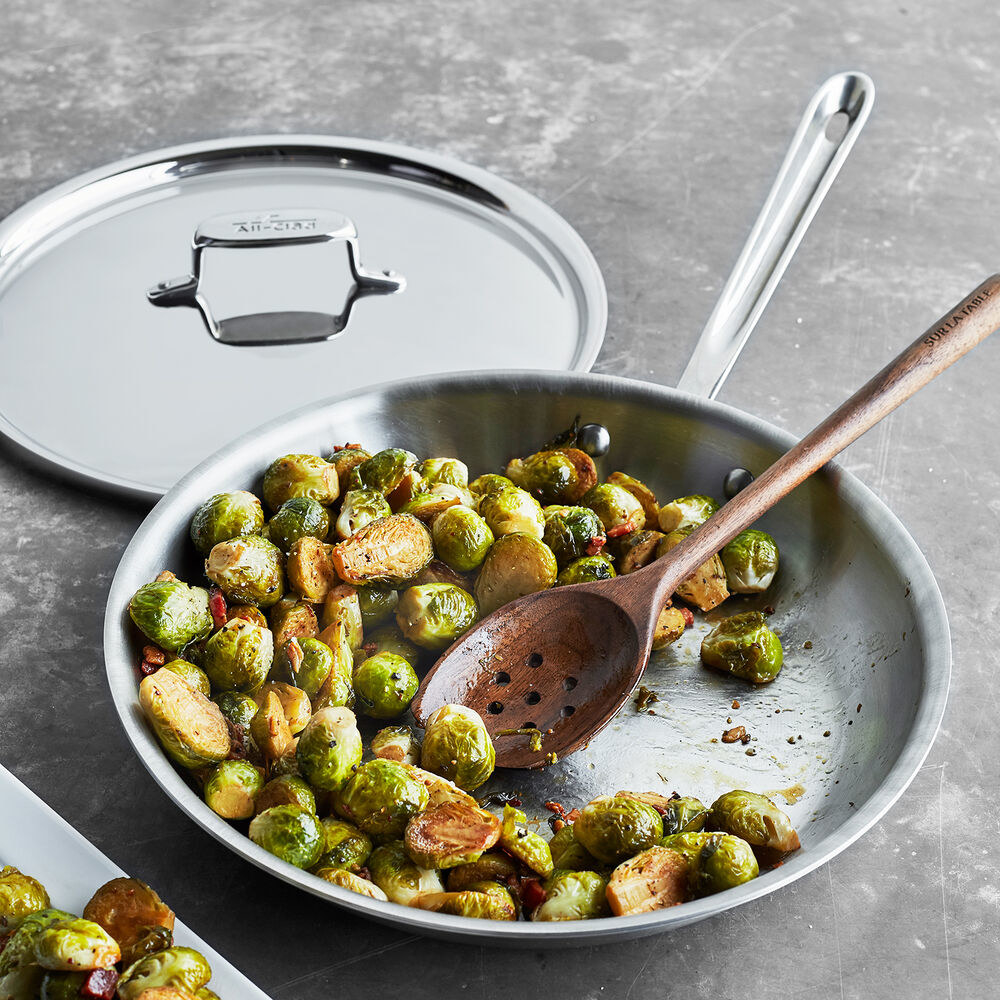 All-Clad stainless steel skillet with brussels sprouts
