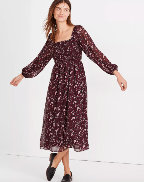 Model wearing peasant-style midi dress with square neck and a floral print