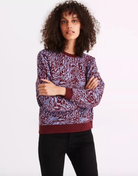 Model wearing blue and burgundy tiger print sweatshirt