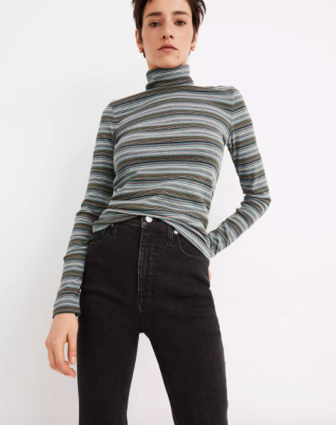 Model wearing gray striped fitted turtleneck shirt
