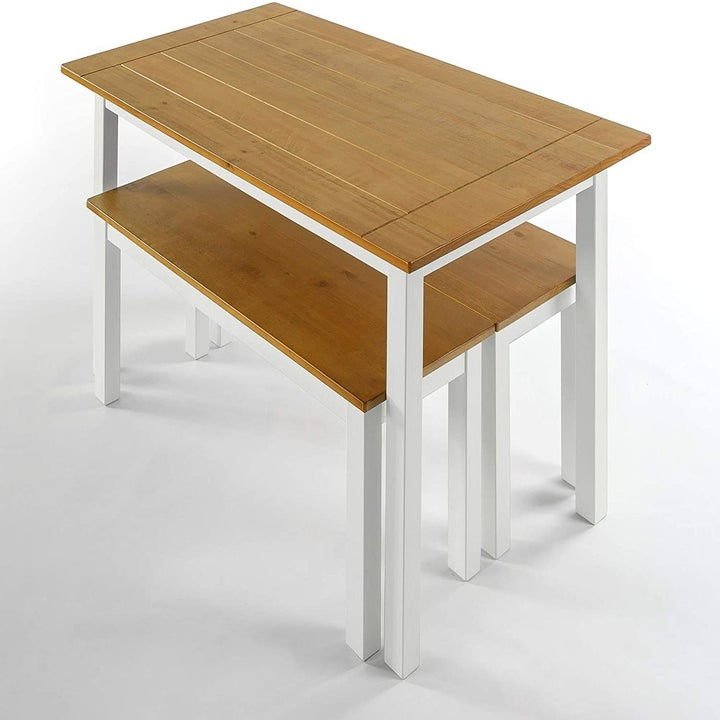 the table with a lighter wood top and white legs