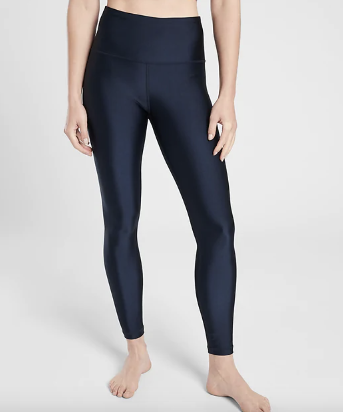 close up of a model wearing the elation shine tights in navy
