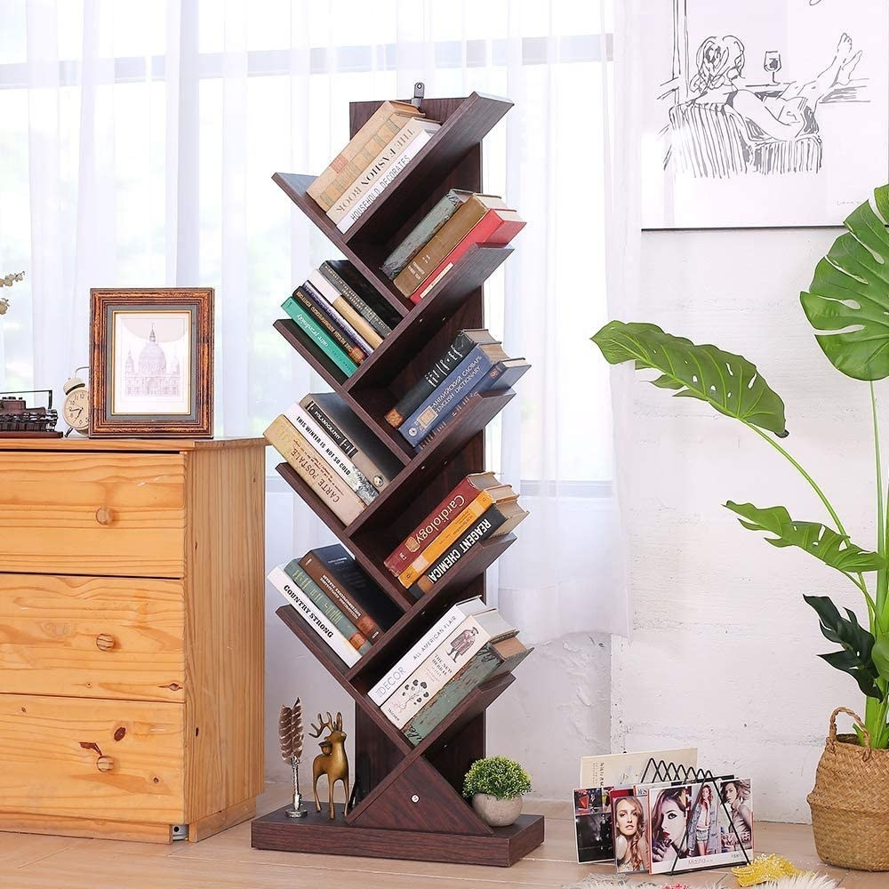 a walnut colored shelf with slanted shelves throughout