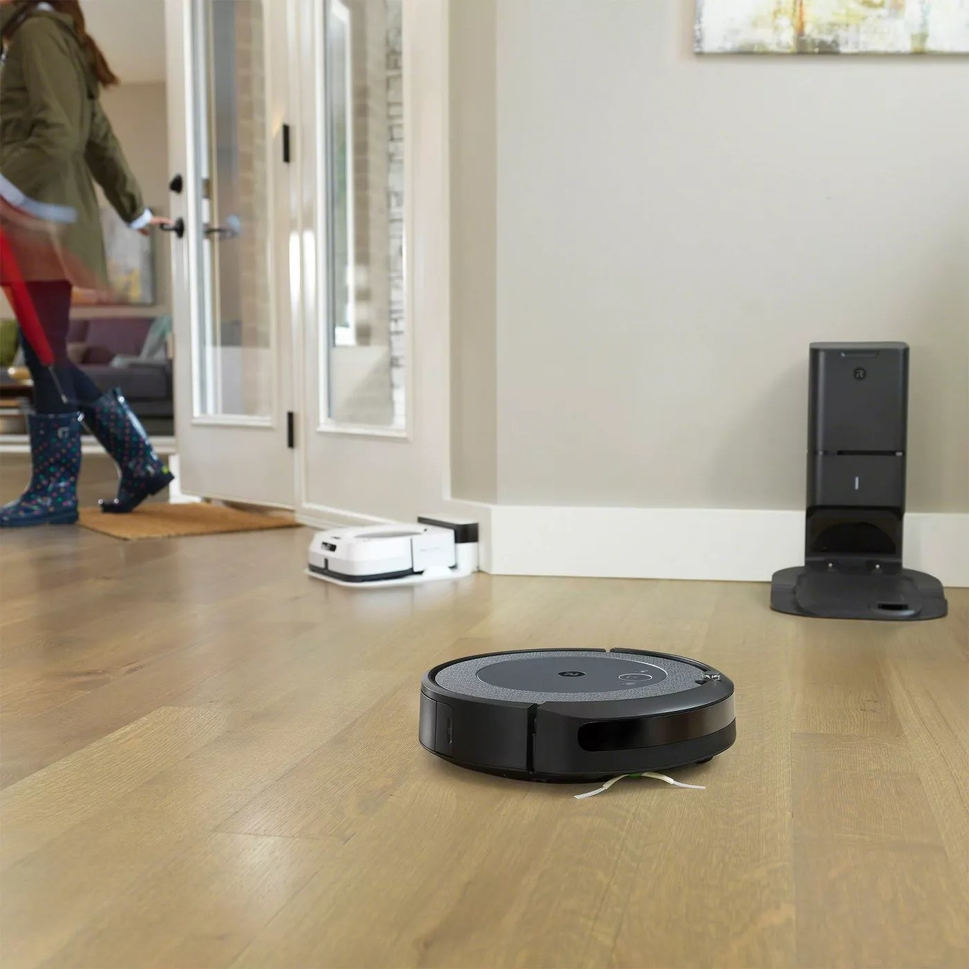 The Roomba vacuum and its base