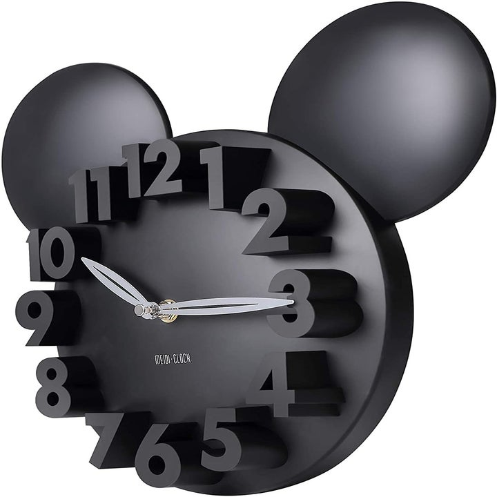 a white mickey shaped clock with 3d numbers