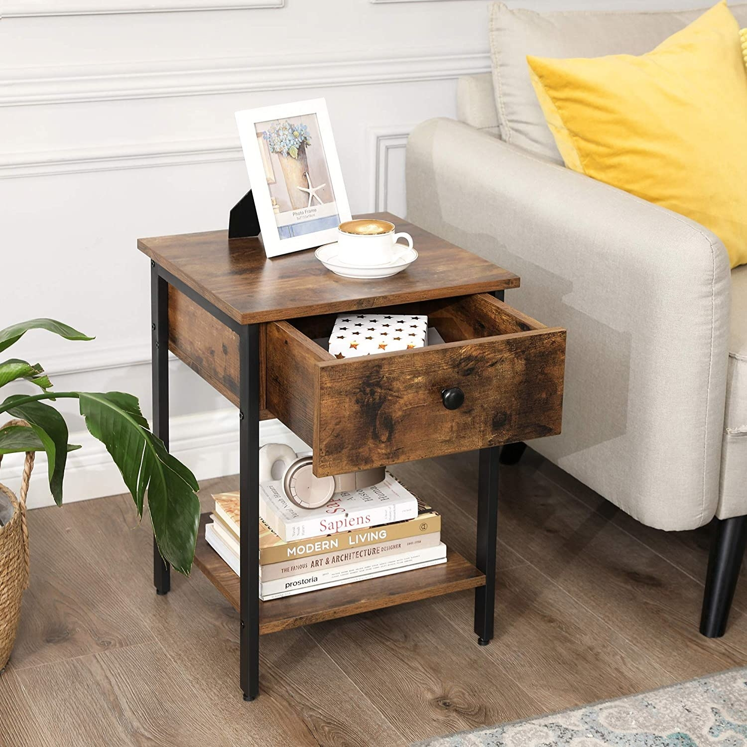 the medium colored wood nightstand with a drawer open