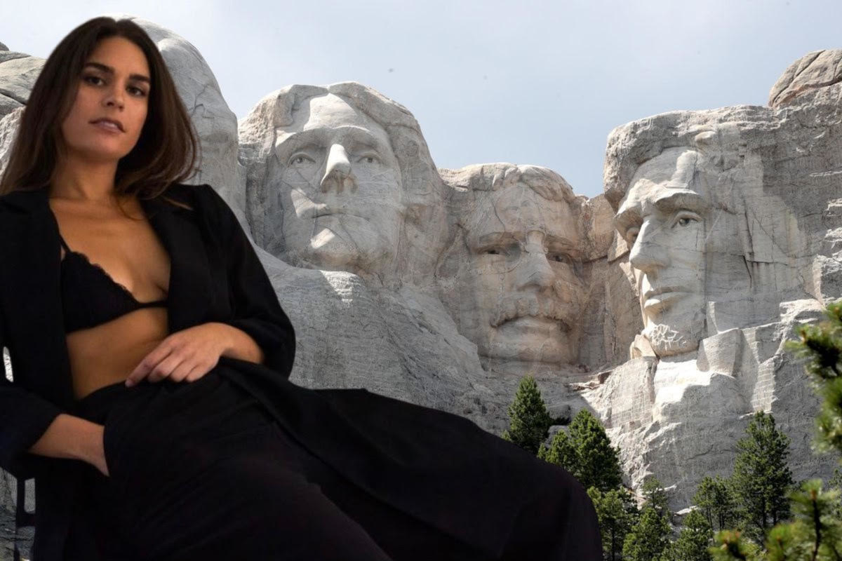 A photoshopped image of Cali in a bralette shows her in front of Mount Rushmore