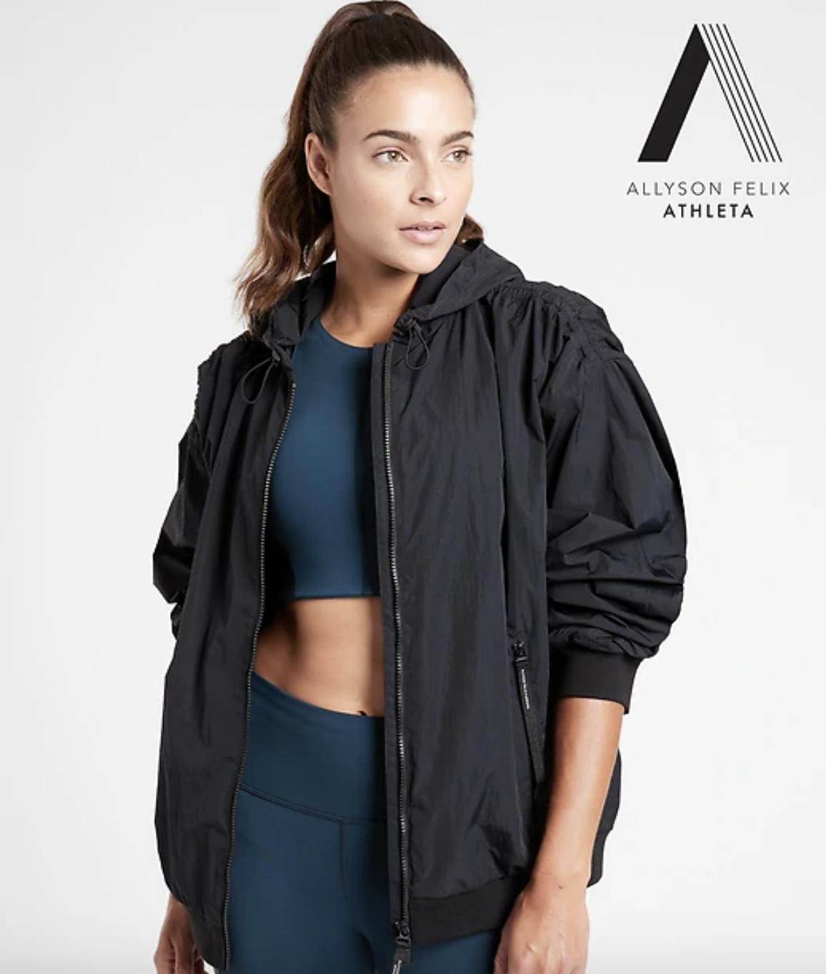 a model wears the black Legend Oversized Jacket open