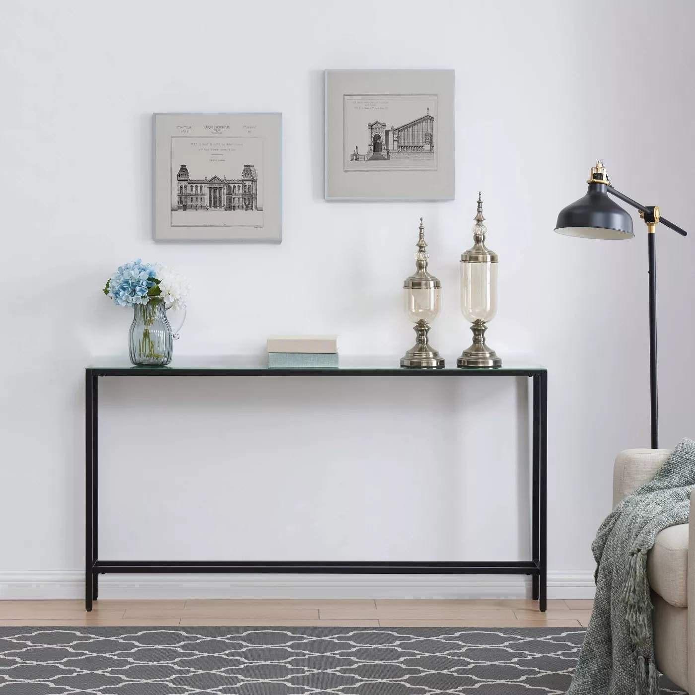 The console table with a black frame and glass top