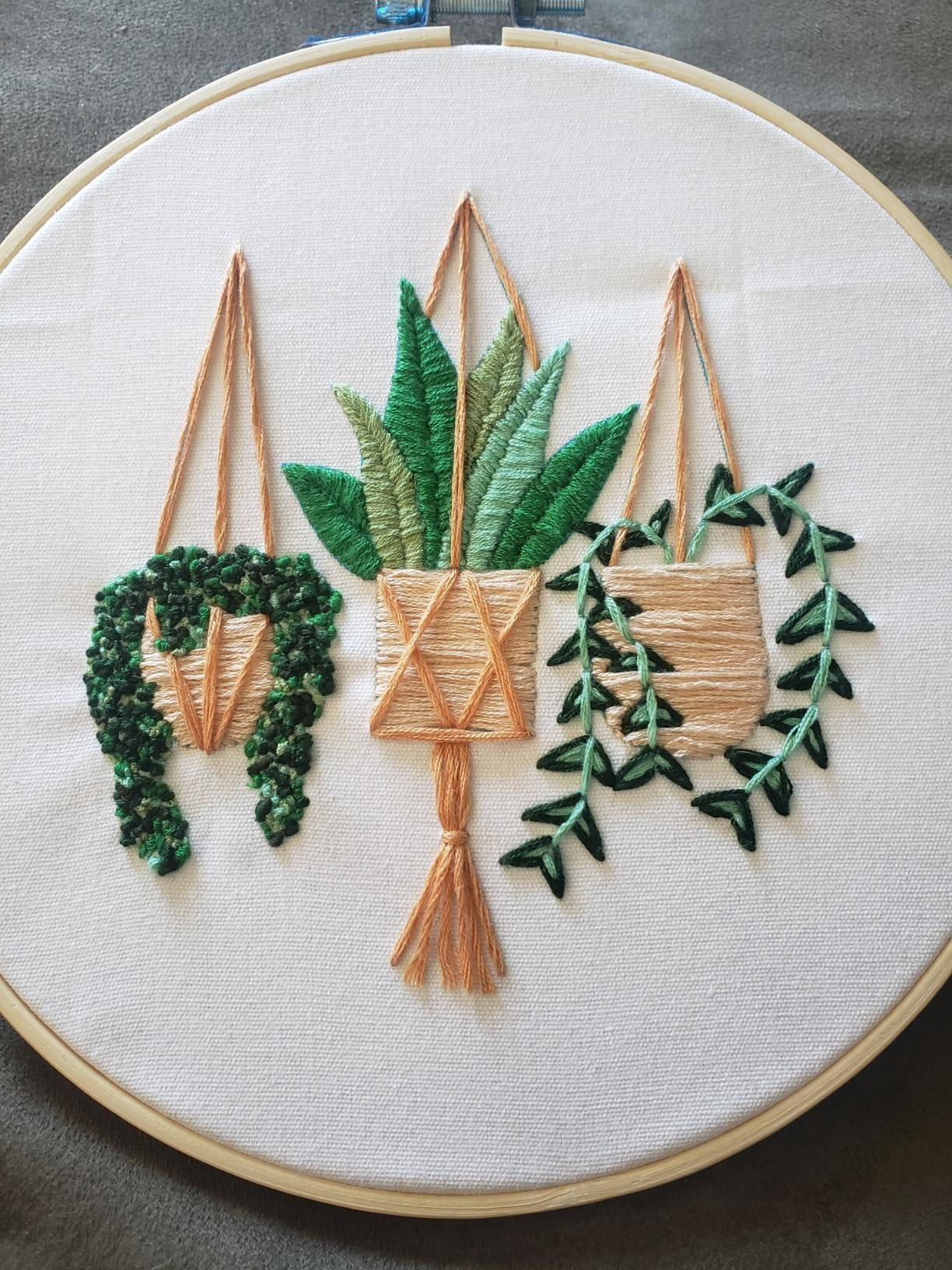 three embroidered plants in a hoop
