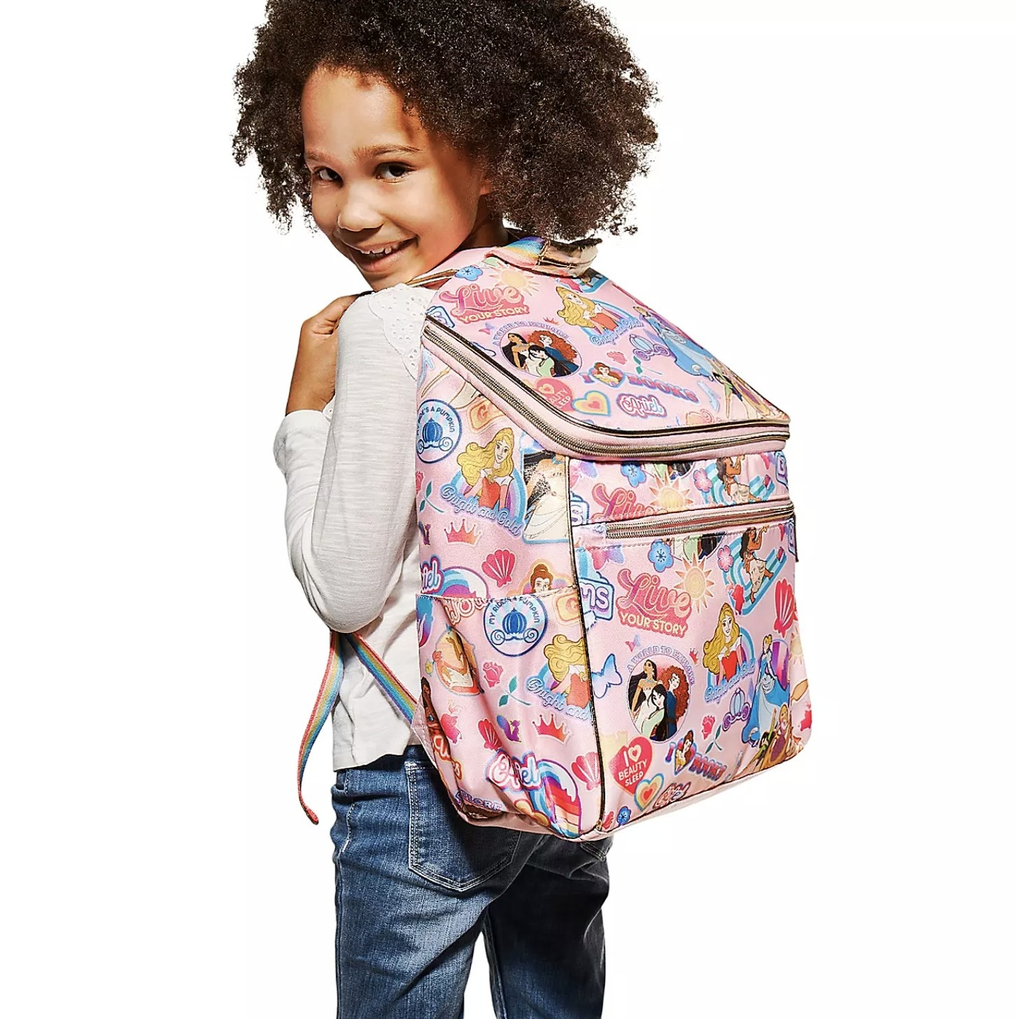 Person wearing the pink backpack with princesses all over it