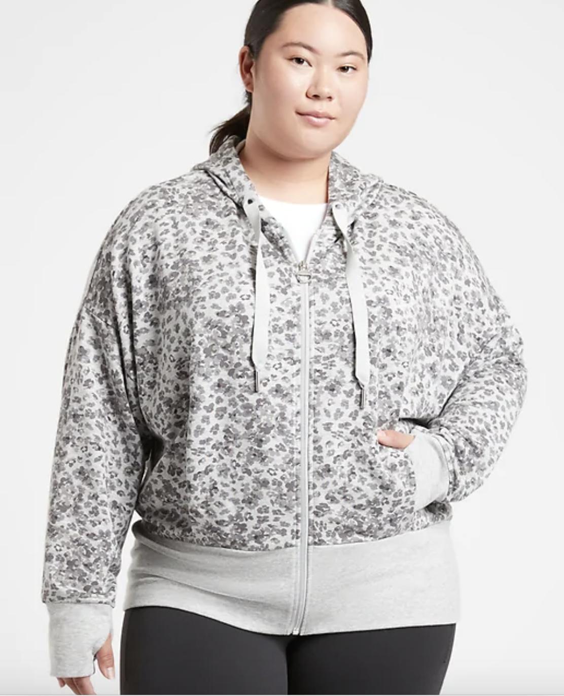 a plus size model wears the balance printed sweatshirt