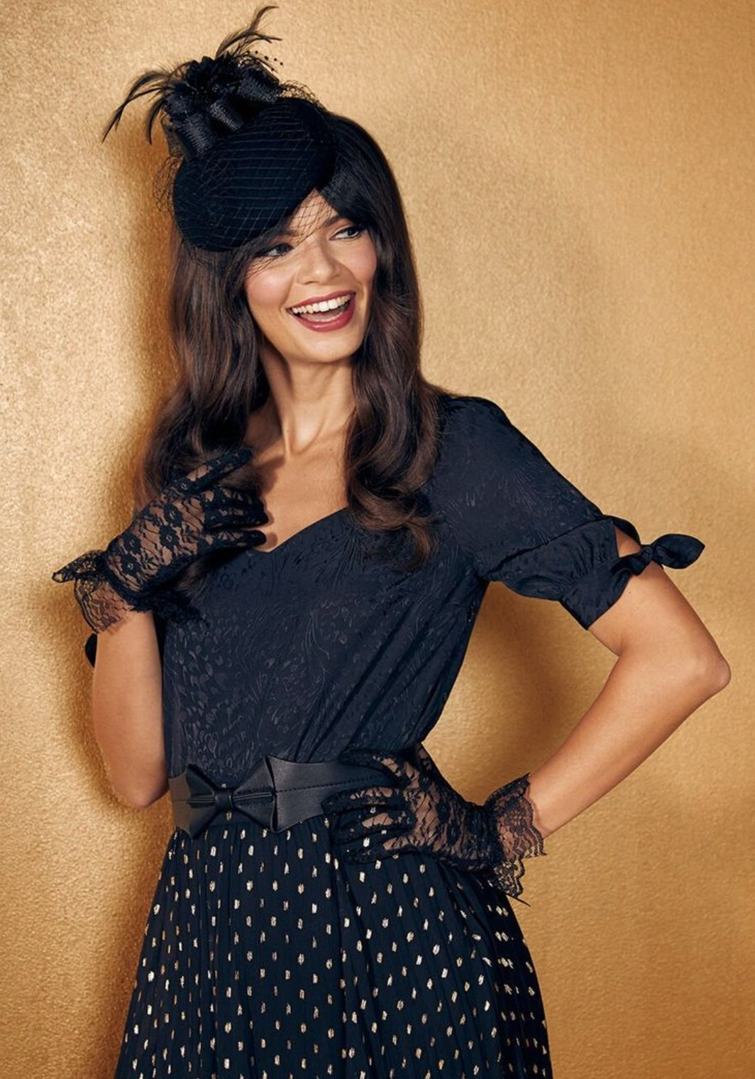 Model wearing the blouse in black